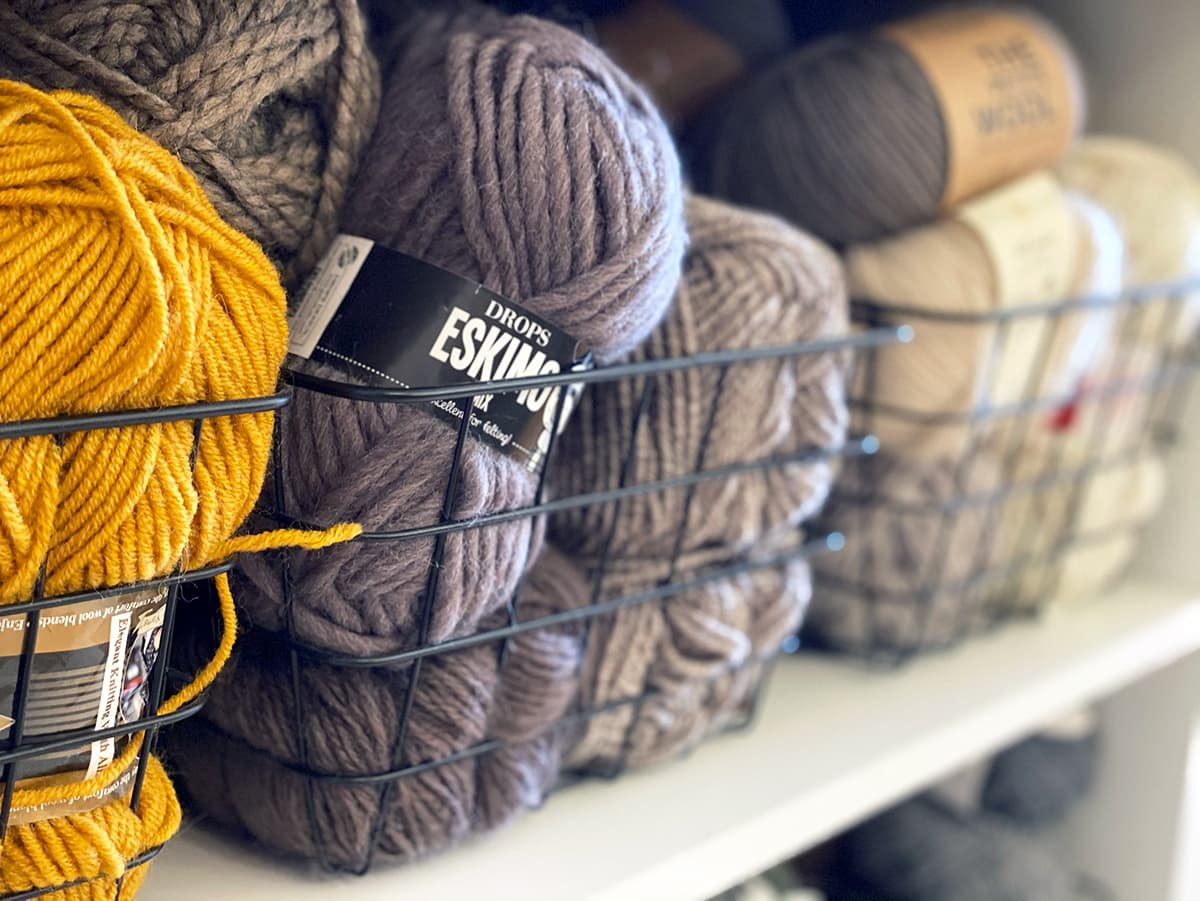 yarn in baskets on shelves