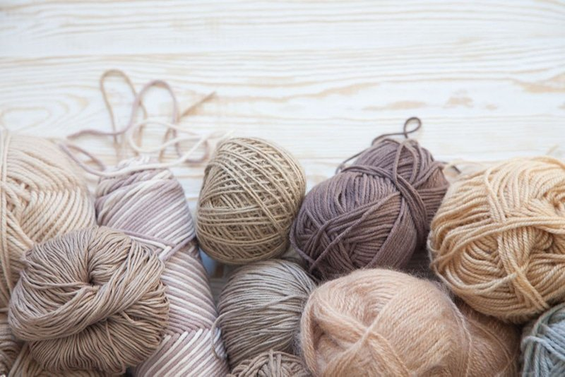 different yarns in shaed of brown and other neutral colours